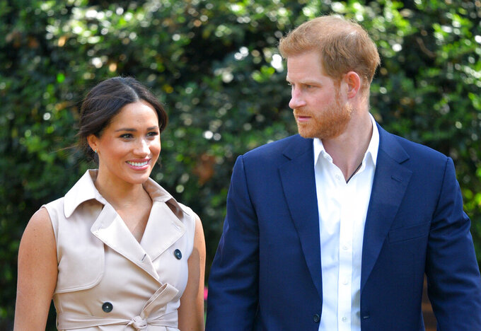 FILE - In this Oct. 2, 2019, file photo, Britain's Prince Harry and Meghan Markle appear at the Creative Industries and Business Reception at the British High Commissioner's residence in Johannesburg. Their first Netflix series will center on the Invictus Games, which gives sick and injured military personnel and veterans the opportunity to compete in sports. The Duke and Duchess of Sussex's Archewell Productions announced Tuesday its first series to hit the streaming service. (Dominic Lipinski/Pool via AP, File)
