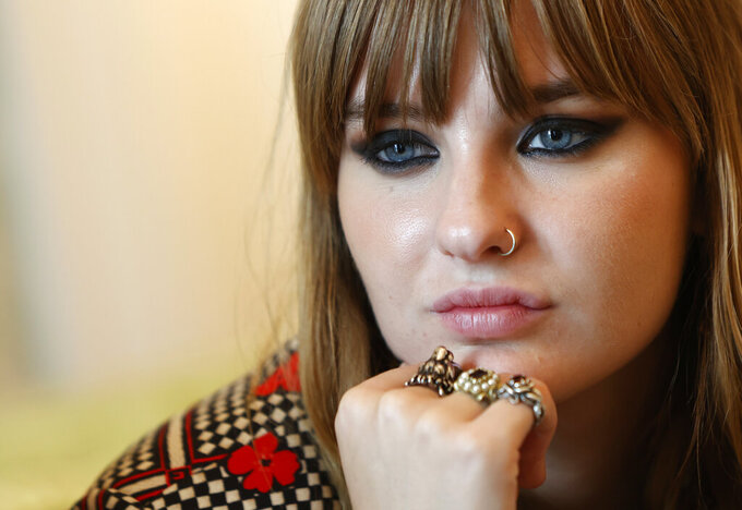 Victoria De Angelis, bass player of Italian band Maneskin, winners of the Eurovision Song Contest in May, listens during an interview with the Associated Press at a hotel in Rome, Tuesday, July 27, 2021.  (AP Photo/Riccardo De Luca)