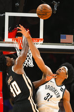 Atlanta Hawks center Damian Jones and Brooklyn Nets center Jarrett Allen (31) vie for a rebound during the first half of an NBA basketball game Wednesday, Dec. 4, 2019, in Atlanta. (AP Photo/John Amis)