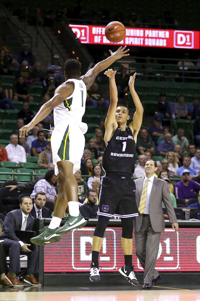 Central Arkansas guard Rylan Bergersen (1) shoots past Baylor guard Mark Vital (11) in the first half of an NCAA college basketball game Tuesday, Nov. 5, 2019, in Waco, Texas. (AP photo/ Jerry Larson)