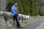 Chuck Christian, of Randolph, Mass., the first former Michigan football player to publicly say that a team doctor abused him, stands for a photograph, Wednesday, April 22, 2020, near his home, in Randolph. Christian, a 60-year-old artist, said during a videoconferencing interview Wednesday, April 22, that the late Dr. Robert Anderson gave him unnecessary rectal exams before he played for the Wolverines during 1977-80 seasons. (AP Photo/Steven Senne)