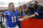 Florida quarterback Kyle Trask (11) celebrates with fans after defeating Tennessee in an NCAA college football game, Saturday, Sept. 21, 2019, in Gainesville, Fla. (AP Photo/John Raoux)