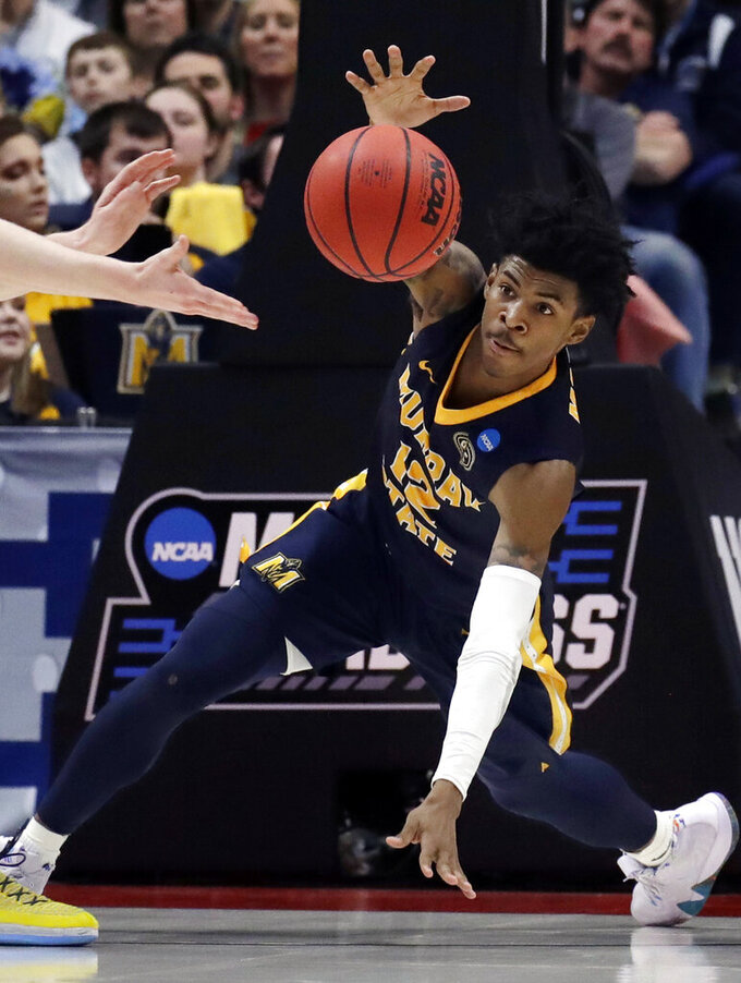 Murray State's Ja Morant (12) scrambles for the ball during the second half of a first round men's college basketball game against Marquette in the NCAA Tournament, Thursday, March 21, 2019, in Hartford, Conn. (AP Photo/Elise Amendola)