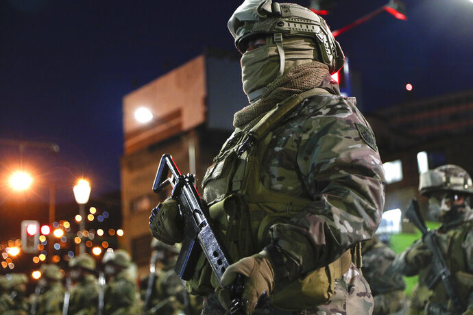 Military police forces guard La Paz, Bolivia, Saturday, Oct. 17, 2020 ahead of Sunday's general election. The upcoming presidential election gives Bolivians a chance for a political reset as they struggle with the dramatic costs of the COVID-19 pandemic. (AP Photo/Juan Karita)