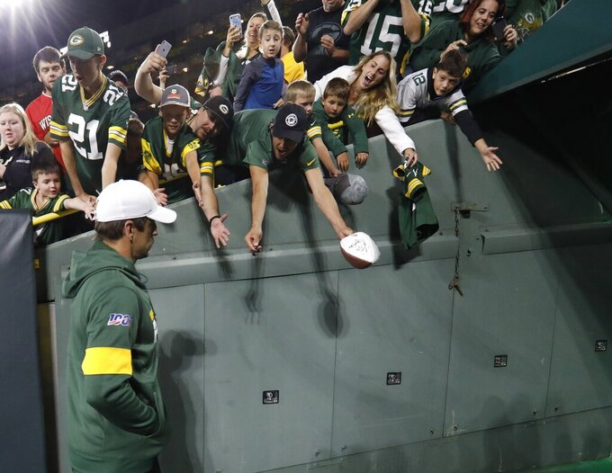 Green Bay Packers' Aaron Rodgers leaves the field after a preseason NFL football game against the Kansas City Chiefs Thursday, Aug. 29, 2019, in Green Bay, Wis. (AP Photo/Mike Roemer)
