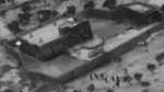 FILE - This Oct. 26, 2019, file image from video released by the Department of Defense, and displayed at a Pentagon briefing, shows U.S. Special Forces, figures at lower right, moving toward compound of Islamic State leader Abu Bakr al-Baghdadi. In his last months on the run, al-Baghdadi was agitated, fearful of traitors, sometimes disguised as a shepherd, sometimes hiding underground, always dependent on a shrinking circle of confidants. (Department of Defense via AP, File)