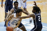 Duke guard DJ Steward (2) and forward Henry Coleman III guard North Carolina guard Kerwin Walton (24) during the first half of an NCAA college basketball game in Chapel Hill, N.C., Saturday, March 6, 2021. (AP Photo/Gerry Broome)