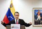 Venezuela's Foreign Minster Jorge Arreaza speaks during a press conference after visiting the International Criminal Court in The Hague, Netherlands, Thursday, Feb. 13, 2020. (AP Photo/Phil Nijhuis)
