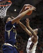 Georgia Tech's James Banks III (1)blocks a shot by Virginia Tech's Nickeil Alexander-Walker (4) during the first half of an NCAA college basketball game Wednesday, Feb. 13, 2019, in Blacksburg, Va. (Matt Gentry/The Roanoke Times via AP)