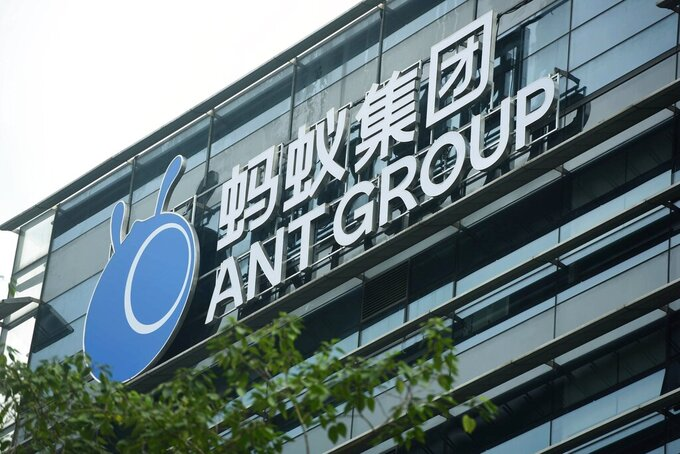 FILE - In this Oct. 26, 2020, file photo, a view of the signage of Ant Group is seen at the headquarters compound of the fintech giant in Hangzhou in eastern China's Zhejiang province. Chinese regulators have ordered Alibaba Group Holding's financial affiliate Ant Group to become a financial holding company that could be regulated more stringently and cease anti-competitive behavior, months after its record initial public offering was halted.(Chinatopix Via AP, File)