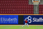 Cincinnati Reds' Sonny Gray (54) throws in the outfield during team baseball practice at Great American Ballpark in Cincinnati, Friday, July 3, 2020. (AP Photo/Aaron Doster)