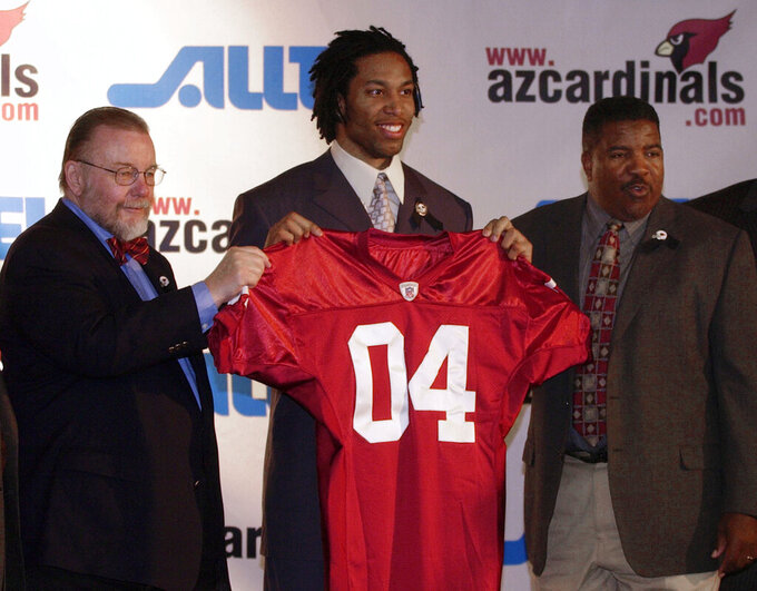 FLE - In this April 25, 2004, file photo, Arizona Cardinals owner Bill Bidwell, left, and coach Dennis Green, right, pose with first round NFL Draft pick wide receiver Larry Fitzgerald at a news conference in Tempe, Ariz. The Cardinals' franchise has been around for more than a century but current star receiver Larry Fitzgerald is arguably the most important player in franchise history. Fitzgerald has been a beloved piece of the Cardinals since he was drafted 3rd overall in 2004 and has been among the most productive receivers in NFL history with more than 17,000 career yards receiving.  (AP Photo/Tom Hood, File)