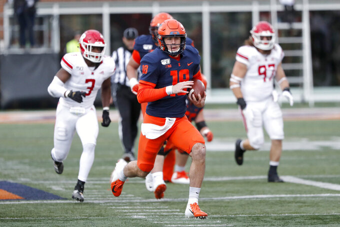 Illinois quarterback Brandon Peters runs for 54-yards during the second half of an NCAA college football game against Rutgers, Saturday, Nov. 2, 2019, in Champaign, Ill. (AP Photo/Charles Rex Arbogast)