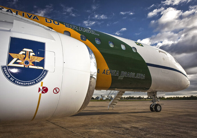 This Feb. 2, 2011 photo released by the Brazilian Ministry of Defense shows a support aircraft parked at an air base in Brasilia, Brazil. Brazilian officials are confirming that an Air Force sergeant is accused of trying to smuggle cocaine into Spain on this plane as he was working on a support mission for President Jair Bolsonaro's trip to the G-20 summit in Japan. (Johnson Barros/FAB/Defense Ministry of Brazil via AP)