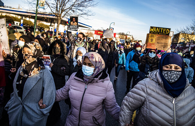 Protesters rally against police brutality, Sunday, Jan. 3, 2021, in Minneapolis, at the gas station where Dolal Idd was shot by Minneapolis police several days earlier. (Richard Tsong-Taatarii/Star Tribune via AP)