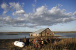 In this Tuesday, Oct. 22, 2019 photo, a barn sits in floodwaters in Pacific Junction, Iowa. Flooding along the Missouri River has stretched on for seven months in places and could endure through the winter, leaving some Upper Midwest farmland and possibly some homes encased in ice. The icy flooding is possibly due to a still-high river, saturated ground, broken levees and a forecast for a wetter-than normal winter. (AP Photo/Nati Harnik)