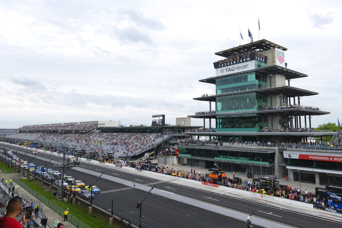 The field crosses the start/finish line on the start of the NASCAR Brickyard 400 auto race at the Indianapolis Motor Speedway, Sunday, Sept. 8, 2019, in Indianapolis. (AP Photo/AJ Mast)