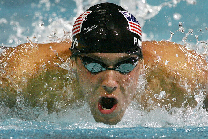 FILE - In this Aug. 19, 2004, file photo, Michael Phelps, of the United States, swims to a gold medal in the 200-meter individual medley at the Olympic Aquatic Centre during the 2004 Olympic Games in Athens. (AP Photo/Mark Baker, File)