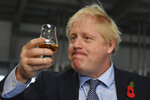 Britain's Prime Minister Boris Johnson tastes whisky during a general election campaign visit to Diageo's Roseisle Distillery near Elgin, north east Scotland, Thursday Nov. 7, 2019. Prime Minister Boris Johnson told British voters Wednesday that they have to back his Conservatives if they want an end to Brexit delays, as he tried to shake off a rocky start to the governing party's election campaign. (Daniel Leal-Olivas/Pool via AP)