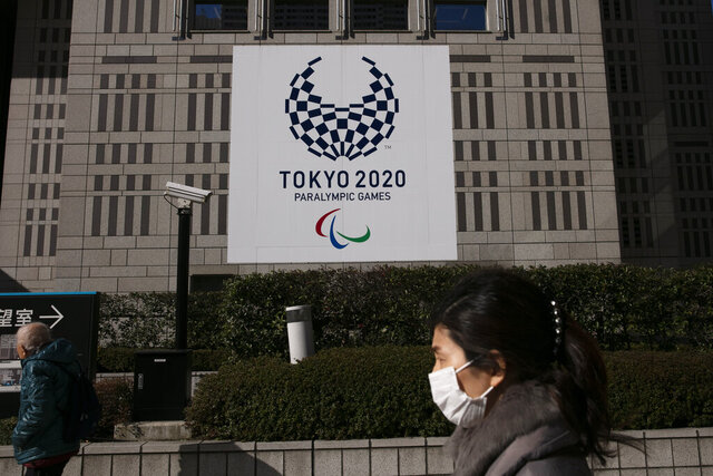 A Tokyo 2020 Paralympics banner hangs on the facade of the Tokyo metropolitan government building Tuesday, Feb. 18, 2020, in Tokyo. Tokyo Olympic organizers said last week there is no