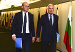 European Union chief Brexit negotiator Michel Barnier, right, walks with Irish Foreign Minister Simon Coveney prior to a meeting at EU headquarters in Brussels, Friday, Sept. 27, 2019. Michel Barnier is meeting with Irish Foreign Minister Simon Coveney and UK Brexit secretary Stephen Barclay on Friday, seeking a way to unblock the stalled negotiations on Britain's withdrawal from the bloc. (Johanna Geron, Pool Photo via AP)