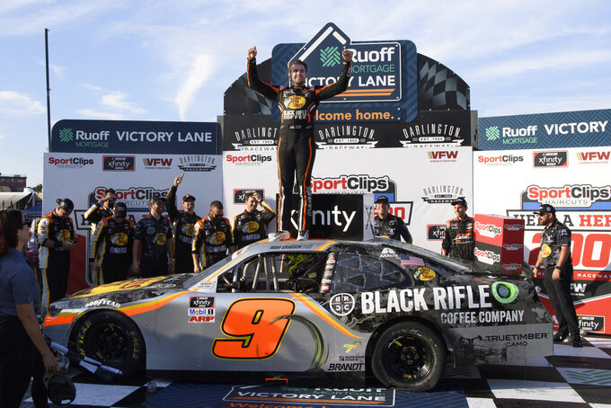 Noah Gragson celebrates in victory lane with his crew after winning a NASCAR Xfinity Series auto race Saturday, Sept. 4, 2021, in Darlington, S.C. (AP Photo/John Amis)
