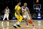DePaul guard Devin Gage (3) drives to the basket against Marquette guard Markus Howard (0) during the first half of an NCAA college basketball game on Tuesday, Feb. 12, 2019. in Chicago, Ill. (AP Photo/Matt Marton)