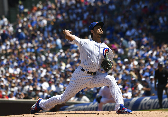 Chicago Cubs starting pitcher Yu Darvish (11) throws the ball during the first inning of a baseball game against the Milwaukee Brewers, Sunday, Aug. 4, 2019, in Chicago. (AP Photo/David Banks)