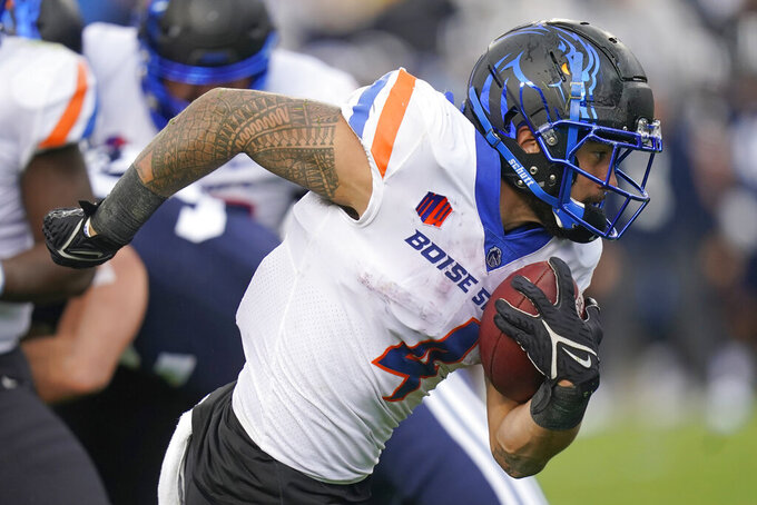Boise State running back Cyrus Habibi-Likio (4) carries the ball in the first half during an NCAA college football game against BYU Saturday, Oct. 9, 2021, in Provo, Utah. (AP Photo/Rick Bowmer)