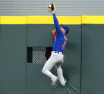 Chicago Cubs center fielder Albert Almora Jr. goes to the wall to rob Atlanta Braves' Tyler Flowers of a home run during the second inning of a baseball game Wednesday, May 16, 2018, in Atlanta. (Curtis Compton/Atlanta Journal-Constitution via AP)