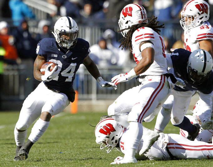 Penn State's Miles Sanders (24) runs the ball against Wisconsin during the first half of an NCAA college football game in State College, Pa., Saturday, Nov. 10, 2018. (AP Photo/Chris Knight)