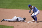 Chicago White Sox's Luis Robert (88) dives back to second base as Kansas City Royals shortstop Adalberto Mondesi (27) attempts a pickoff during the sixth inning of a baseball game at Kauffman Stadium in Kansas City, Mo., Sunday, Sept. 6, 2020. (AP Photo/Orlin Wagner)
