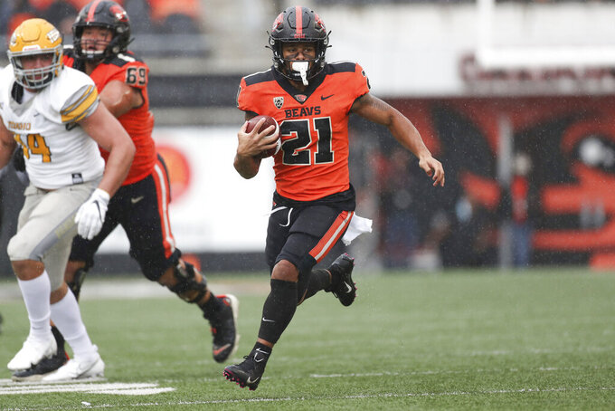 Oregon State running back Trey Lowe (21) carries the ball against Idaho during the second half of an NCAA college football game Saturday, Sept. 18, 2021, in Corvallis, Ore. Oregon State won 42-0. (AP Photo/Amanda Loman)