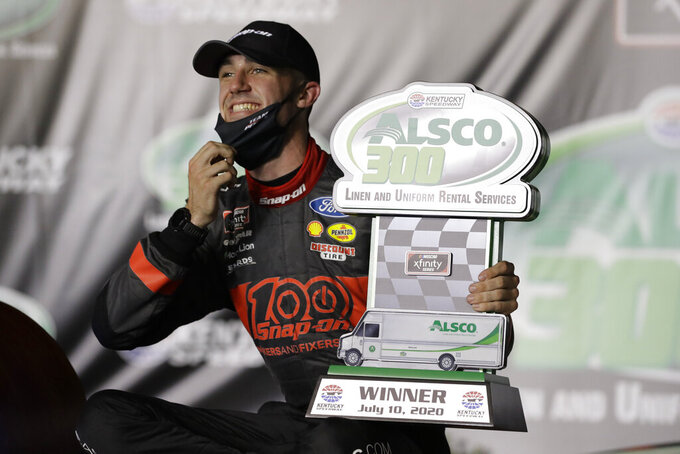 Austin Cindric (22) smiles after winning a NASCAR Xfinity Series auto race Friday, July 10, 2020, in Sparta, Ky. (AP Photo/Mark Humphrey)