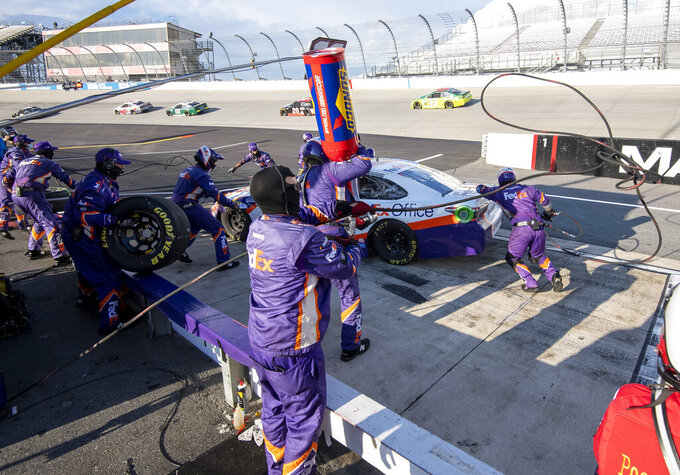 Denny Hamlin (11) pits during a NASCAR Cup Series auto race at Dover International Speedway, Sunday, Aug. 23, 2020, in Dover, Del. (AP Photo/Jason Minto)