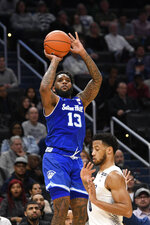 Seton Hall guard Myles Powell (13) shoots against Georgetown guard Jahvon Blair (0) during the first half of an NCAA college basketball game, Wednesday, Feb. 5, 2020, in Washington. (AP Photo/Nick Wass)