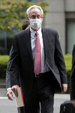 Former Nissan Motor Co. executive Greg Kelly arrives for the first trial hearing at the Tokyo District Court in Tokyo Tuesday, Sept. 15, 2020. The financial misconduct trial of Kelly opened Tuesday. Japanese prosecutors outlined allegations of what they said was a complex and clandestine scheme to pay former star executive Carlos Ghosn. (Kiyoshi Ota/Pool Photo via AP)
