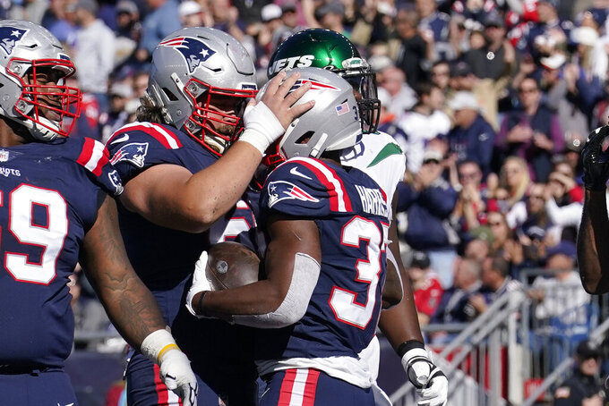 New England Patriots running back Damien Harris (37) is congratulated by center David Andrews after his touchdown during the first half of an NFL football game against the New York Jets, Sunday, Oct. 24, 2021, in Foxborough, Mass. (AP Photo/Steven Senne)