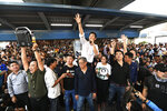 Thailand's Future Forward Party leader Thanathorn Juangroongruangkit talks to his supporters during rally in Bangkok, Thailand, Saturday, Dec. 14, 2019. Several thousand supporters of a popular Thai political party, under threat of dissolution, packed a concourse in central Bangkok on Saturday in one of the largest political demonstrations in recent years.(AP Photo/Str)