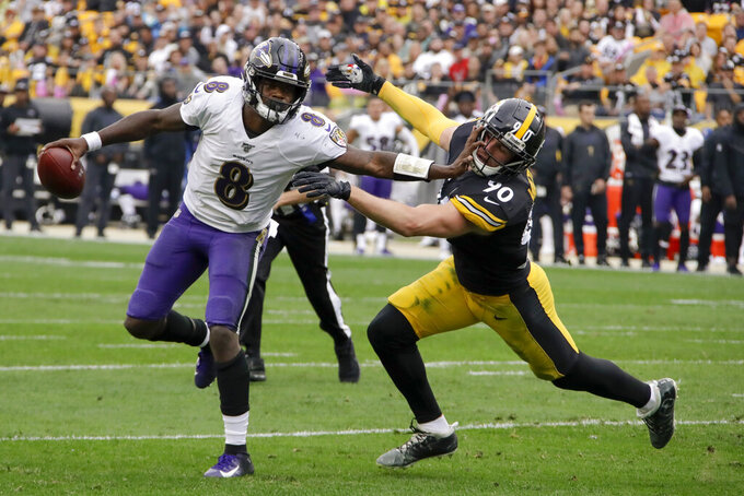 Baltimore Ravens quarterback Lamar Jackson (8) scrambles away from Pittsburgh Steelers outside linebacker T.J. Watt (90) in the first half of an NFL football game, Sunday, Oct. 6, 2019, in Pittsburgh. (AP Photo/Gene J. Puskar)