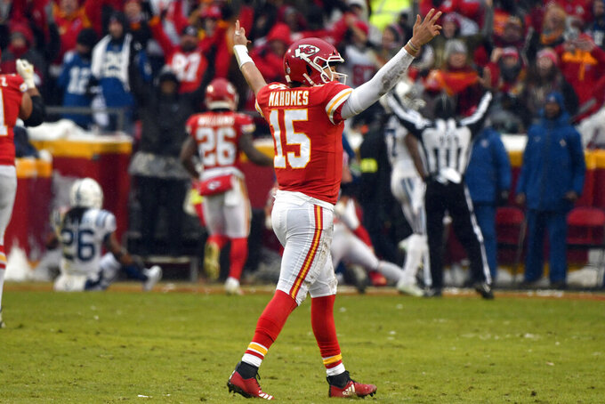 Kansas City Chiefs quarterback Patrick Mahomes (15) celebrates a touchdown by wide receiver Tyreek Hill (10) during the first half of an NFL divisional football playoff game against the Indianapolis Colts in Kansas City, Mo., Saturday, Jan. 12, 2019. (AP Photo/Ed Zurga)