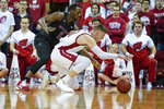 Rutgers' Mamadou Doucoure, left, and Wisconsin's Micah Potter go after the ball during the first half of an NCAA college basketball game Sunday, Feb. 23, 2020, in Madison, Wis. (AP Photo/Andy Manis)