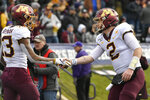 Minnesota wide receiver Rashod Bateman (13) celebrates with quarterback Tanner Morgan (2) after catching a touchdown pass during the second half of an NCAA football game against Northwestern Saturday, Nov. 23, 2019, in Evanston, Ill. Minnesota won 38-22. (AP Photo/Paul Beaty)