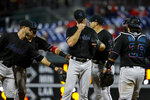 Miami Marlins relief pitcher Tyler Kinley, center, wipes his face as he is pulled during the eighth inning of a baseball game against the Philadelphia Phillies, Friday, April 26, 2019, in Philadelphia. Philadelphia won 4-0. (AP Photo/Matt Slocum)