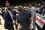 Maryland guard Anthony Cowan Jr. gets a hug from coach Mark Turgeon, front, after an NCAA college basketball game against Iowa, Tuesday, Feb. 19, 2019, in Iowa City, Iowa. Maryland won 66-65. (AP Photo/Charlie Neibergall)