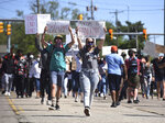 Hundreds of people walk down Pipestone Street in Benton Harbor, Mich., Sunday, May 31, 2020, during a protest march concerning police brutality and the death of black men including George Floyd while being restrained by Minneapolis police. (Don Campbell/The Herald-Palladium via AP)