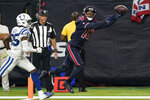 Houston Texans wide receiver DeAndre Hopkins (10) makes a touchdown catch past Indianapolis Colts cornerback Pierre Desir (35) during the second half of an NFL football game Thursday, Nov. 21, 2019, in Houston. (AP Photo/David J. Phillip)