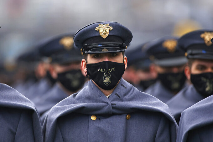 An Army cadet marches on the field before an NCAA college football game against Navy on Saturday, Dec. 12, 2020, in West Point, N.Y. (AP Photo/Adam Hunger)