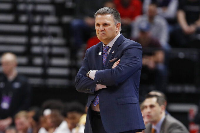 New Mexico State head coach Chris Jans reacts in the first half against Auburn during a first round men's college basketball game in the NCAA Tournament Thursday, March 21, 2019, in Salt Lake City. (AP Photo/Jeff Swinger)