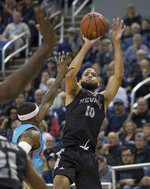 Nevada forward Caleb Martin (10) shoots a three-point shot against New Mexico in the first half of an NCAA college basketball game in Reno, Nev., Saturday, Feb. 9, 2019. (AP Photo/Tom R. Smedes)